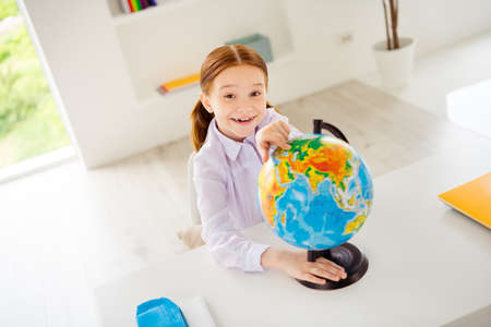Top above high angle view photo of excited lovely cute charming kid search mainland answer question feel rejoice positive white blouse shirt modern foxy ginger hairstyle tails pigtails ponytails 版權商用圖片