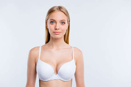 Healthy lifestyle concept. Portrait of nice cute lovely winsome fascinating attractive blonde girl wearing bra isolated over light gray background