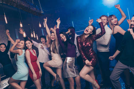 Portrait of funny funky people youth have move ecstatic thrilled evening party maker dress high-heels formalwear indoors holiday time carefree person concept