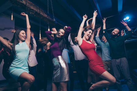Nice gorgeous attractive glamorous slim fit cheerful positive stylish girls and guys having fun event life lifestyle occasion festal celebratory feast in fashionable luxury place nightclub indoors Foto de archivo