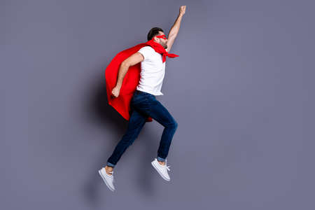 Full length body size profile side view of his he nice-looking attractive strong sportive macho bearded guy rising hand up goal attainment isolated over gray pastel background Stock Photo