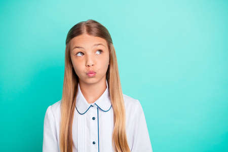 Close-up portrait of nice-looking attractive lovely girlish winsome charming pensive pre-teen girl pout lips isolated on bright vivid shine blue turquoise background Stok Fotoğraf
