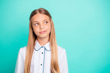 Close-up portrait of nice-looking attractive lovely winsome charming pensive curious smart clever pre-teen girl isolated on bright vivid shine blue green turquoise background Stok Fotoğraf