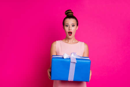 Portrait of cute lovely sweet millennial hold hand impressed scream wow omg unbelievable unexpected incredible holiday wear skirt dress she her top-knot pastel-colored isolated pink background Reklamní fotografie