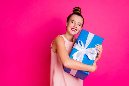 Portrait of charming lovely youth millennial have gift close eyes expect ribbon white pomade dressed dress top-knot fashionable she her isolated pink background