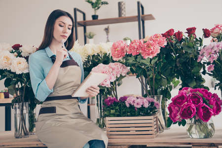 Portrait of serious focused concentrated lady self-employed people hold hand thoughtful have thoughts retail small start-up wear blue modern shirt stylish trendy beautiful indoors Stock Photo