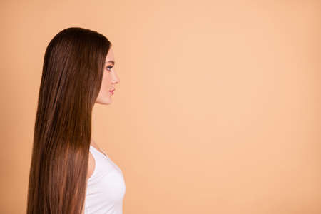 Profile side view portrait of her she nice-looking lovely sweet attractive well-groomed gorgeous candid lady smooth soft repair hair copy space isolated over beige background