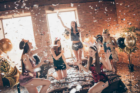 Nice gorgeous attractive lovely slim fit slender cheerful cheery glad carefree group bunny ears birthday having fun dormitory campus in loft industrial brick style interior room house indoors