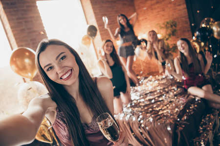 Self-portrait of nice chic charming cute sweet winsome feminine attractive lovely cheerful glad group chill out festive celebratory in loft industrial brick style interior room house indoors