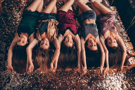 Top night angle above view photo of diverse lovely cute sweet pretty slim ladies meeting gathering having entertainment funny talks stylish trend modern shorts singlets tank-tops lying on sheets linen