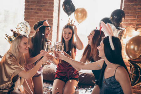 Nice attractive feminine adorable lovely royal cheerful group ladies bride-maids having fun congrats greeting wedding bride festive day in golden decorated loft industrial style interior room