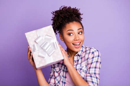 Close up photo funny funky lady teen teenager astonished impressed by pastel box white ribbon for anniversary 14-february 8-march hold hand wear checked shirt trendy stylish isolated purple background
