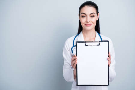 Close up photo beautiful lady doctor hospital showing place signing list patient anamnesis insurance wear phonendoscope white science costume specs eyeglasses eyewear isolated grey background