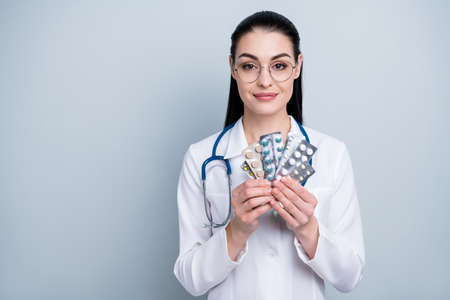 Close up photo beautiful lady doctor hospital showing pharmaceutical novelty analogues headache wear phonendoscope white science costume specs eyeglasses eyewear isolated grey background