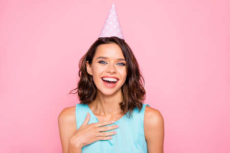 Close up photo amazing beautiful she her lady attractive pretty appearance birthday cap head hooray listen humorous guests story wear shiny colorful blue dress isolated pink bright vivid background