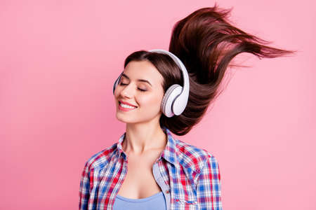 Close up photo beautiful amazing she her lady hairstyle flight overjoyed eyes closed ear flaps favorite playlist sound track audio wear casual checkered plaid shirt clothes isolated pink background Stock Photo