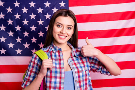 Portrait cute beautiful charming high school person teen advertise suggest advice choose decide ads recommend feedback courses travel uk traveler isolated checkered shirt modern stars flag background