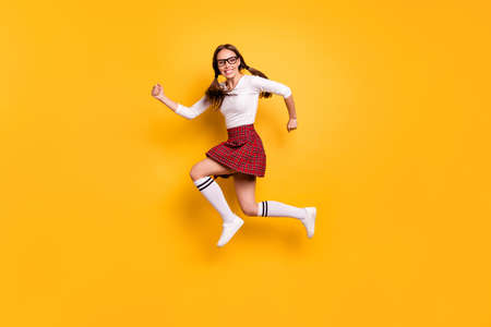 Full length body size view portrait of her she nice attractive lovely cheery cheery glad girl wearing eyeglasses eyewear rapid rush hour sale discount isolated on bright vivid shine yellow background