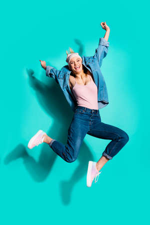 Vertical full length body size profile side view of nice attractive charming cheery sporty slim slender girl having fun spring vacation isolated on bright vivid shine blue green turquoise background