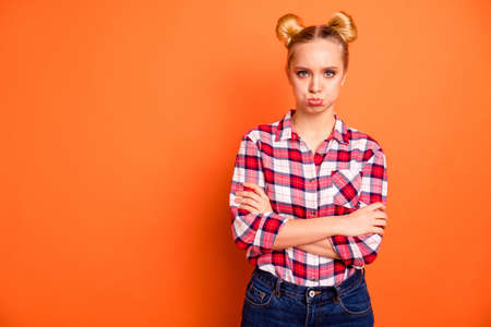 Close up photo attractive beautiful she her lady arms crossed bad mood not satisfied wrong not fair situation offense lips expression wear casual checkered plaid pink shirt isolated orange background Фото со стока - 127523745