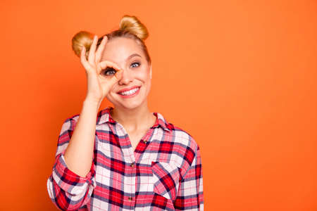 Portrait of nice pretty cute carefree promoter have ads choose decide advise adverts recommendation perfect isolated checked shirt plaid fashionable orange background