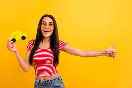 Portrait charming student youth holiday voyage delivery departure hitchhiker amazed scream stylish long hairdo red striped t-shirt trendy eyewear eyeglasses denim jeans isolated yellow background Stock fotó