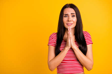 Portrait of funny funky attractive youth made fault misfortune forgive have fear dressed fashionable millennial clothing isolated over bright yellow background Stock Photo