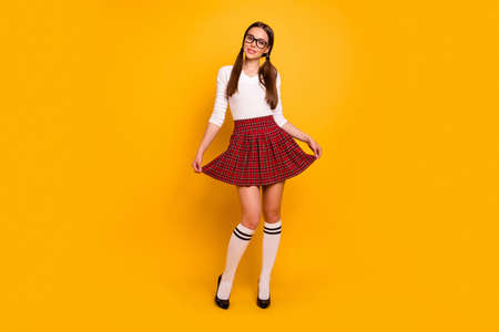 Full length body size view of nice-looking fascinating attractive winsome lovely lovable adorable slender cheerful teen girl isolated over bright vivid shine yellow background