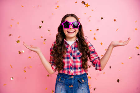 Portrait of cute astonished cheerful nice lady people youth kid hold hand impressed unbelievable stylish trendy unexpected wow omg dressed checked denim jeans clothing over pink background 写真素材