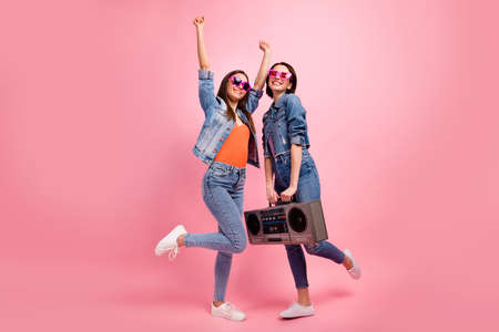 Full length side profile body size photo beautiful she her best ladies festive mood hands arms raised listen playlist vintage recorder wear jeans denim jackets blazers isolated bright pink background 版權商用圖片