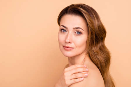 Close up side profile photo beautiful amazing cute charming she her lady hold hand arm touch shoulder perfect condition soft purity result anti-age procedures nude isolated pastel beige background Stock Photo