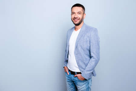 Close up photo amazing he him his guy macho reliable person hands arms pockets pants trousers serenity calm peaceful kind wear jeans denim formal-wear jacket blazer isolated grey background