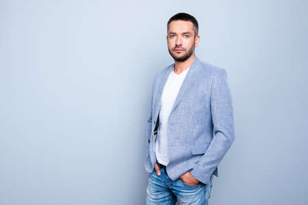 Close up photo amazing he him his guy macho reliable person hands arms, pockets pants trousers serenity calm peaceful kind wear jeans denim formal-wear jacket blazer isolated grey background