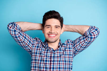 Close up photo amazing funny he him his macho white teeth hands arms behind head healthy refreshed look having day off holiday wear casual checkered plaid shirt isolated bright blue background