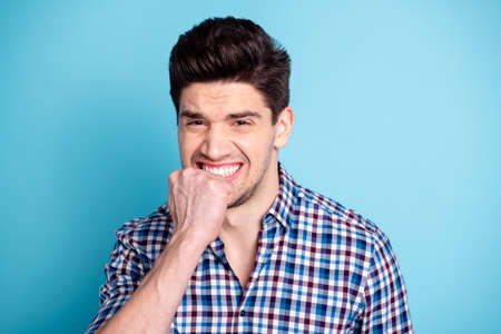 Close up photo disappointed embarrassed man guy millennial bristle funny funky crazy touch fist hand worry education result test concept wear checked fashionable nice clothes isolated blue background