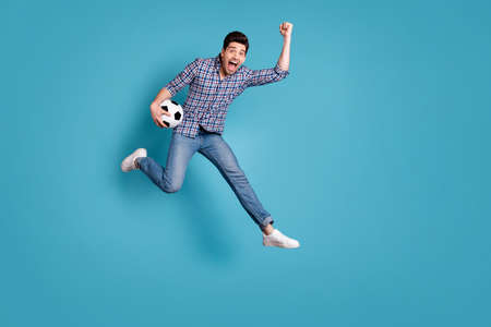Full length body size view photo ecstatic lucky person raise fists shout yeah celebrate goal entertainment wow checked modern stylish trendy denim outfit sneakers free time isolated blue background