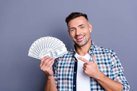 Portrait of positive lovely charming man hold hand have investment finance feel content isolated wear checked plaid shirt white hairstyle grey background 스톡 콘텐츠