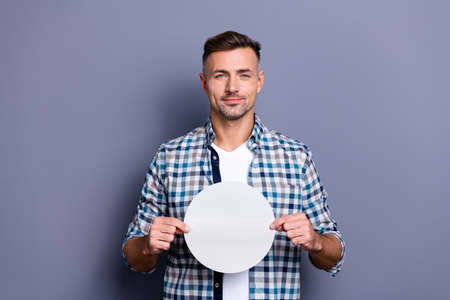 Close up photo handsome he him his guy arms hands holding round circle shape figure form paper list creative designer image picture wear casual plaid checkered shirt isolated grey background