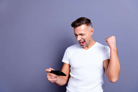 Close up photo amazing he him his middle age yelling macho perfect appearance easy-going telephone hands arms excited video game player best win wear casual white t-shirt isolated grey background