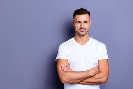 Close up photo amazing he him his middle age macho chief boss perfect ideal appearance easy-going reliable person look calm show white teeth bristle wear casual white t-shirt isolated grey background Фото со стока