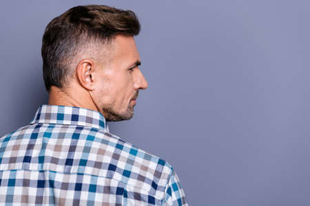 Close-up profile side portrait of his he nice attractive well-groomed experienced bearded guy wearing checked shirt isolated over gray blue violet purple pastel background Stock Photo