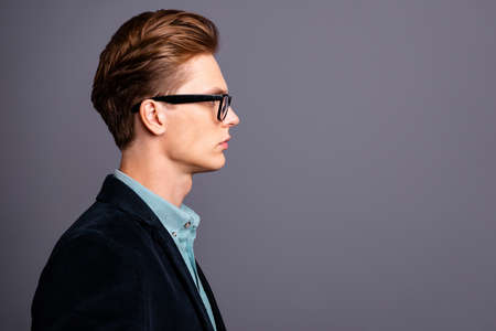 Close up side profile photo amazing he him his guy macho perfect appearance, hairstyle look empty space reliable person not smiling wondered formal-wear shirt velvet jacket isolated grey background