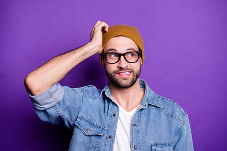 Close-up portrait of his he nice attractive discontent guilty bearded guy isolated over bright vivid shine violet lilac purple background Banco de Imagens