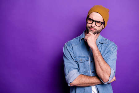 Portrait of his he nice attractive doubtful bearded guy touching chin thinking guessing strategy copy space isolated over bright vivid shine violet lilac purple background