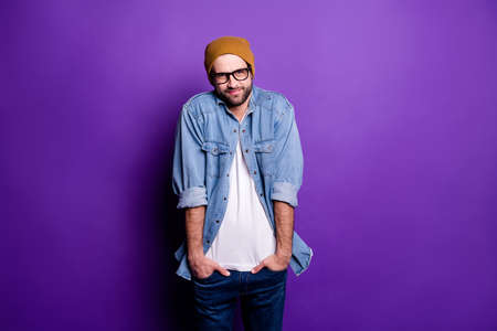 Portrait of his he nice attractive discontent bearded guy holding hands in pockets avoiding ignoring participation isolated over bright vivid shine violet lilac purple background