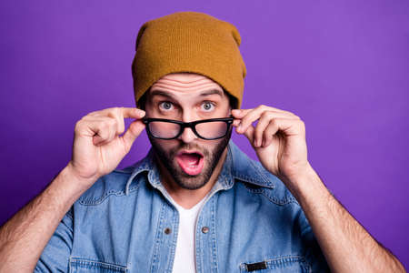 Close-up portrait of his he nice attractive shocked bearded guy putting specs off grimacing isolated over bright vivid shine violet lilac background