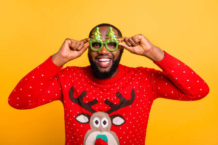 Close-up portrait of his he nice attractive stylish cheerful cheery glad funky guy wearing cool winter Santa look outfit style isolated over bright vivid shine yellow background Imagens