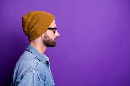 Close-up profile side view portrait of his he nice attractive calm candid bearded guy copy space isolated over bright vivid shine violet lilac purple background