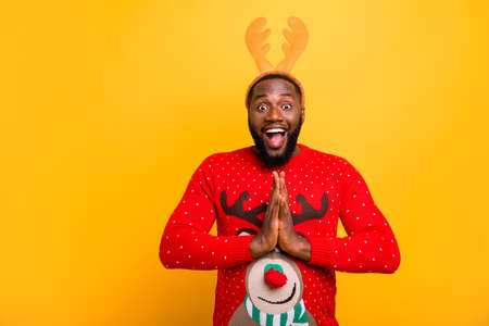 Portrait of his he nice attractive cheerful cheery positive funky guy wearing Santa look outfit style having fun begging fairy winter wish isolated over bright vivid shine yellow background
