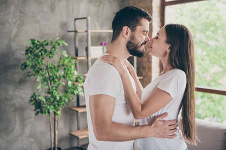 Profile side view portrait of his he her she two nice attractive lovely lovable sweet gentle dreamy charming cheerful cheery people spending day daydream at home house apartment indoors Stock Photo